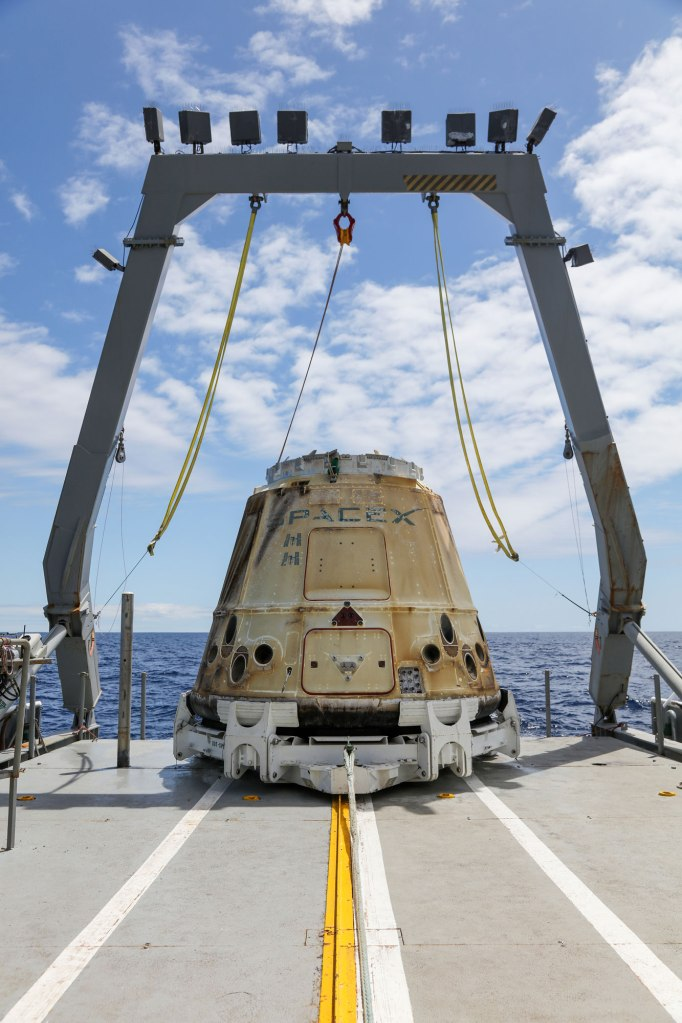 SpaceX CRS-20 Dragon spacecraft after splashdown in the Pacific Ocean.